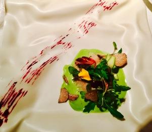 huevo gorootxategui on a liquid herb salad