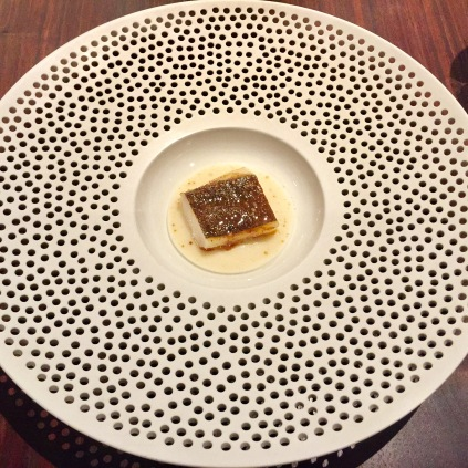 black cod grilled over embers with yogurt sauce and citrus leaves