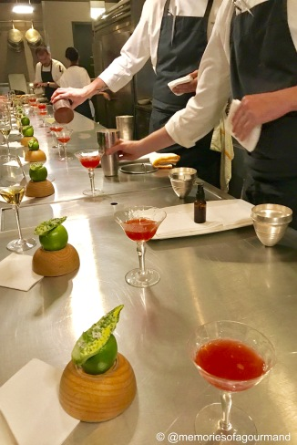 kitchen pass line up with snacks and cocktails