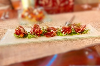 """Jamón Ibérico - honey-mustard grilled pears with """"Rogue Creamery Oregonzola"""" blue cheese and peppery arugula sprouts resting beneath veils of pata negra ham"""