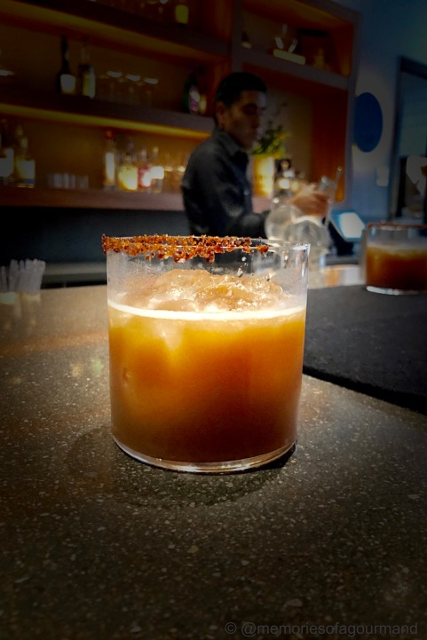 A tamarind mezcal margarita with a rim of 'sal de gusano'