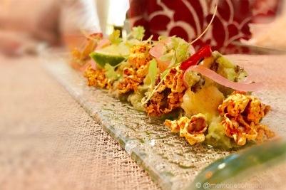Popcorn Shrimp - cilantro & garlic grilled shrimp lacquered with anejo tequila rest atop poblano guacamole and ancho-chili spiced popcorn