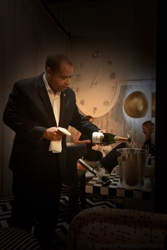 head sommelier karl kuhn pouring some sparkling wine to welcome guests