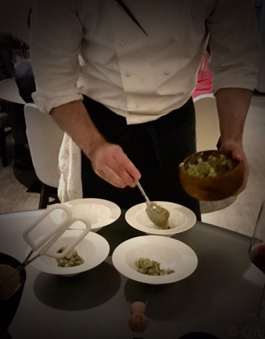 A mixture of potato, bacon and clam is done table side to create Alinea's version of 'clam chowder'